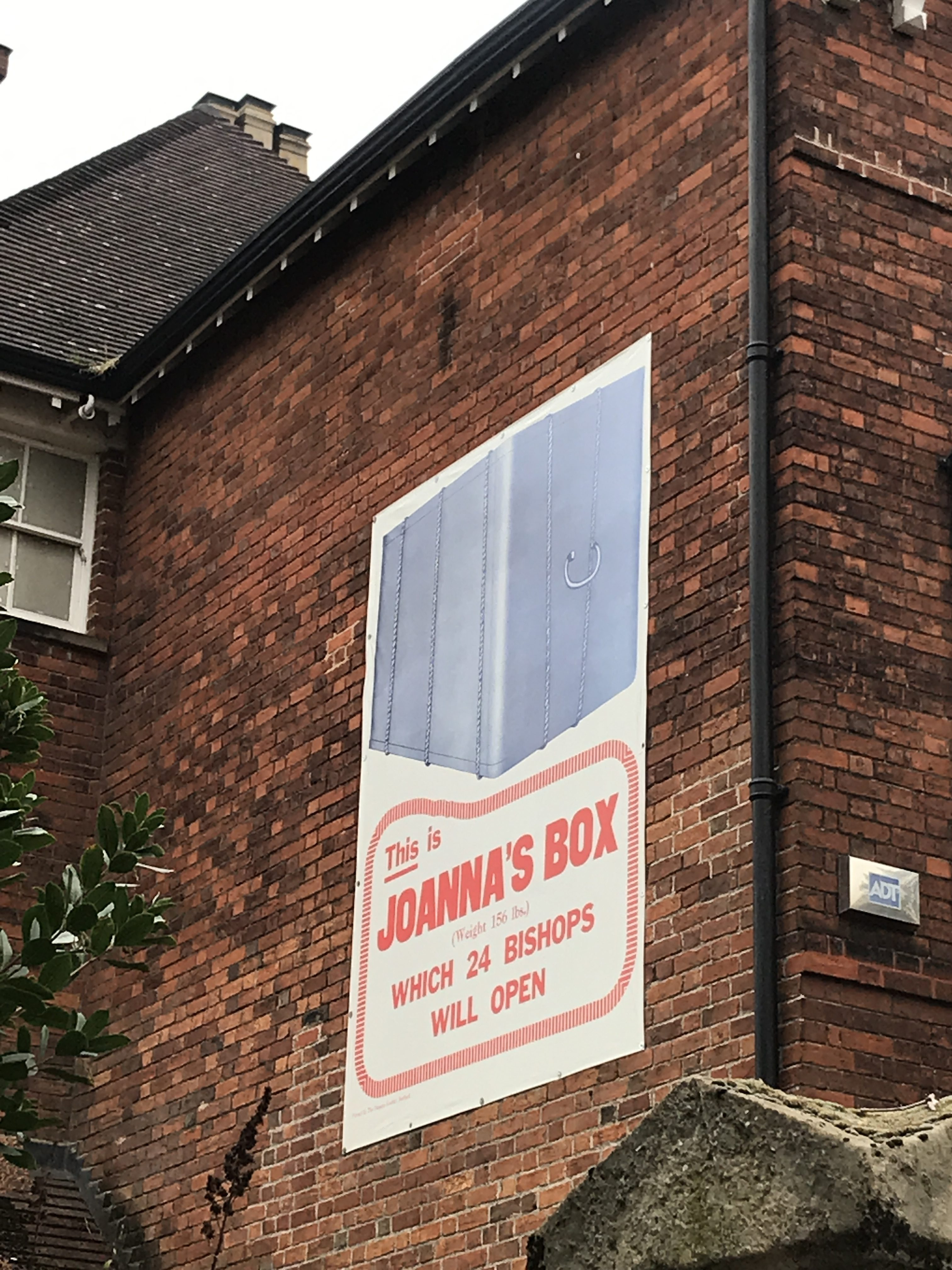 A recreation of an Edwardian poster asking for Joanna Southcott's box to be opened, pasted on the side of The Panacea Museum in Bedford.